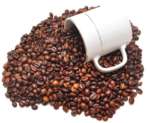 coffee beans falling from a coffee cup