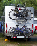 camper with bicycles on a camping site