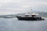 motor yacht anchored near Sardinia coast poster