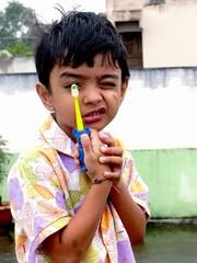 Kid showing his toothbrush
