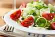 Rice salad with tomatoes, pepper and herbs