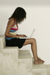 Female sitting on stairs and working on laptpo