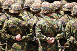 Solders in camouflage poster
