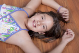 girl lying on the living room floor