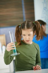 School girl with test tube