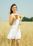 Girl  with beer at field