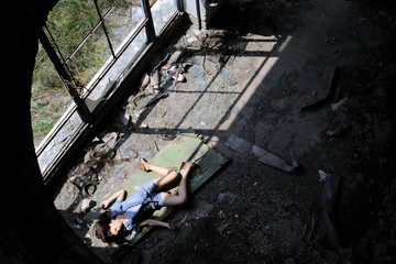 mysterous human body of young woman in devastated place