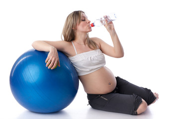 Sports pregnant young woman.