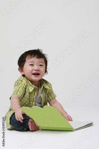Happy Toddler with A Book