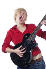 jeune fille hurlant avec une guitare électrique