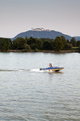 Donau river with boat and castle