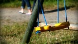 Missed, left or lost child`s playground - swing whithout kids