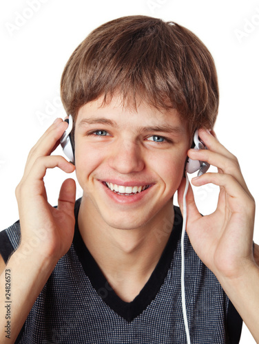 happy young man with headphones listening to music.