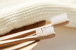Closeup of wooden toothbrush with towel - 24829911