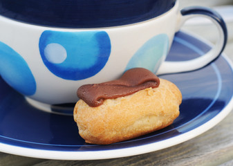 Mini chocolate choux pastry with blue decorated cup