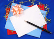 Writing a greeting card to friends and relatives