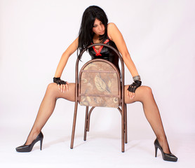 Erotic model sitting on the chair