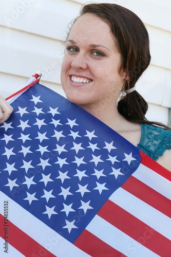 Pretty young girl with 4th of July flag