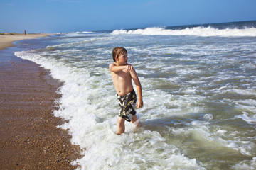 boy in motion at the sea is angry