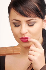 Atractive brunette woman with chocolate