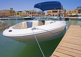 Luxury speedboat moored to a jetty