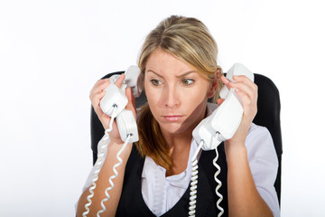cheerful businesswoman answering alot of phones