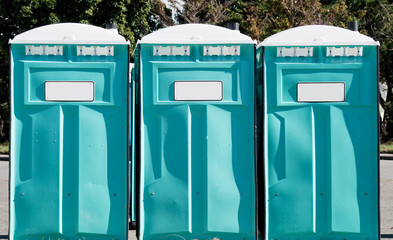 Three portable toilets