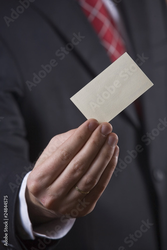 Businessman holding business card - Finance