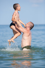 Cute kid and his dad in holiday