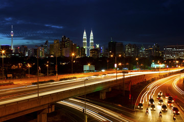 Kuala Lumpur cityscape, with light trails at night.