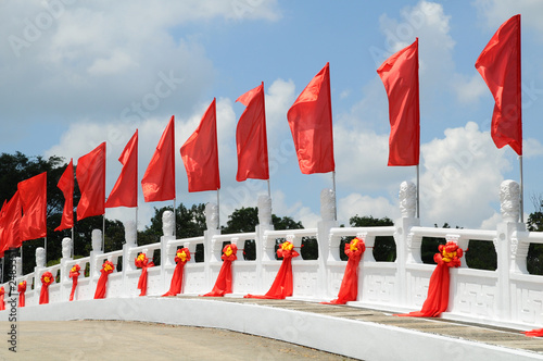 Red Flags Decorating A Bridge