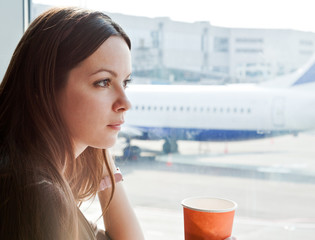 Woman drink coffee in airport