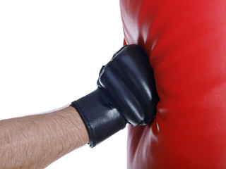 man wearing boxing gloves punching the bag