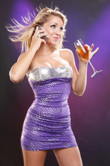 Cute model texting while having wine
