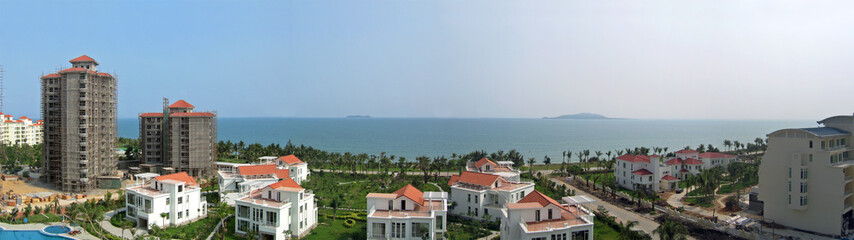 white villas and new construction on the sanya seafront