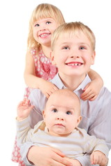 girl, boy and baby. boy is holding bady. isolated.