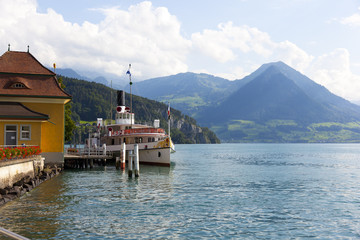 boat leaving vitznau on the lake lucine