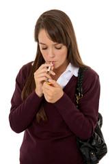 Teen lighting cigarette