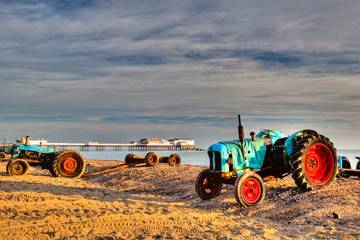 Tractor at Cromer beach in Great Britain