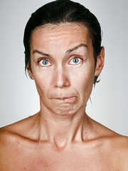 Facial portrait of offended woman with drops on a skin