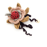 Crocheted flower brooch poster