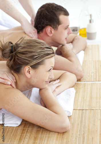 Loving couple receiving a back massage