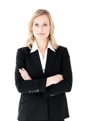 Assertive businesswoman with folded arms looking at the camera