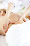 Close-up of a caucasian woman receiving a back massage