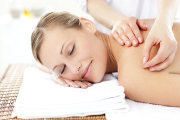 Radiant woman receiving an acupuncture treatment