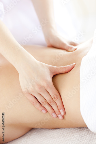 Close-up of a young woman receiving a back massage
