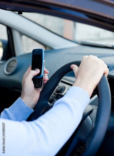 Close-up of a caucasian man sending a message while driving