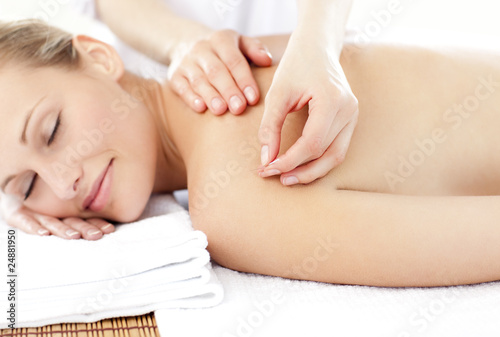 Bright caucasian woman receiving an acupuncture treatment