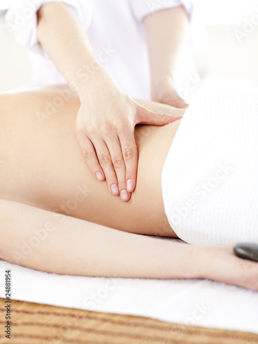 Close-up of a caucasian woman having a back massage in a spa cen