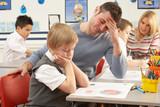 Group Of Primary Schoolchildren And Teacher Having lesson In Cla poster